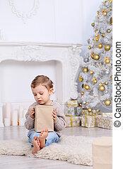 boy under the Christmas tree