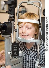 Boy Undergoing Eye Examination Test With Slit Lamp - Smiling...