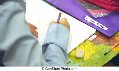 boy unknown draw class paints in album drawing lesson School...