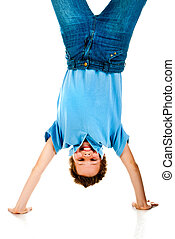 boy upside down on a white background