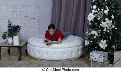 Boy using a smart phone in christmas background