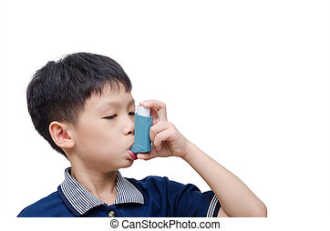 boy using inhaler for asthma