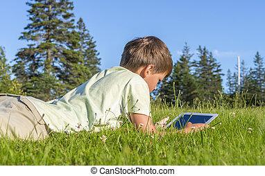 Boy Using iPad - Boy using iPad in the park