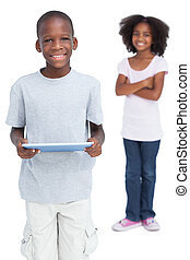 Boy using tablet pc with his sister on a white background