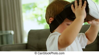 Boy using virtual reality headset at home 4k - close-up of...