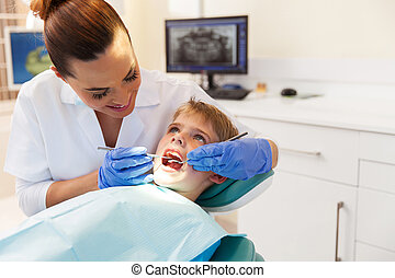 boy visits the dentist for a check up