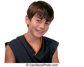 Smiling 10 year old boy with braces.