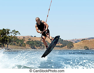 Boy Wakeboarding on the lake