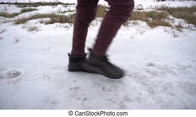 Boy walking on frozen road
