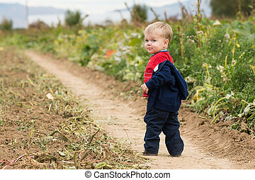 Boy walking through the field - After a hay ride a toddler...