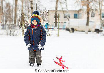 boy walks in the winter outdoors