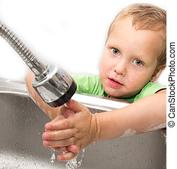 boy washes his hands