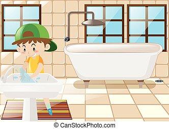 Boy washing hands in toilet