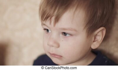 Boy watching a video on sofa