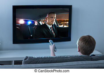 Boy Watching Movie On Television