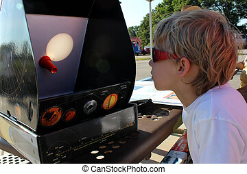 Boy watching the Venus Transit of Sun