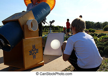 Boy watching the Venus Transit of Sun