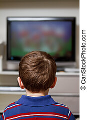 Boy watching TV - boy watching cartoon on TV