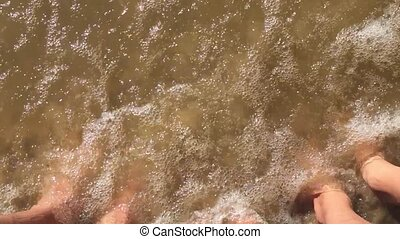 boy water girl and man family legs in the ocean slow motion video. strong waves of sand sea rest family