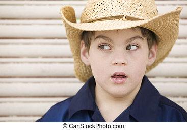 Boy Wearing a Cowboy Hat Looks Left