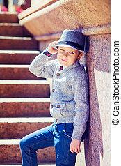 boy wearing a hat - happy stylish boy wearing a hat in the...