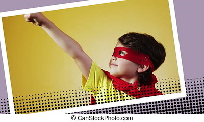 Boy wearing a superhero costume posing