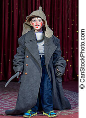 Boy Wearing Over Sized Coat Wearing Clown Make Up