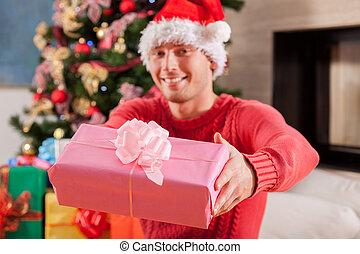 Boy wearing Santa Claus hat