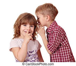 boy whispering a secret little girl