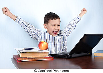 boy winner in computer game or learning a lesson