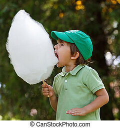 Boy wit candyfloss - Boy eat candyfloss at the park