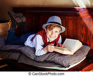 boy with a book - happy stylish boy with a book on the bench