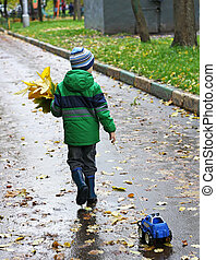 Boy with a bouquet of leaves.