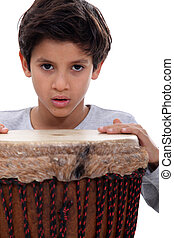 Boy with a djembe drum