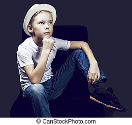 boy with a hat - nine years old boy wearing a hat, against...