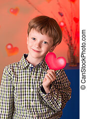 Boy with a heart in his hands