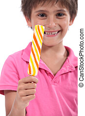Boy with a lolly pop