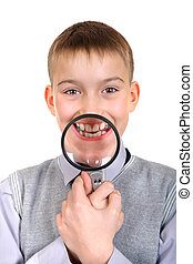 Boy with a Loupe - Boy holds a Loupe in front of his teeth...