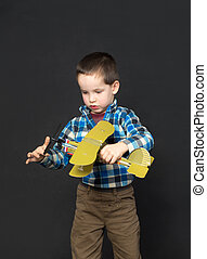 boy with a model airplane