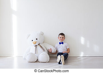 boy with a soft toy of a large bear