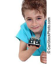 Boy with a toy car