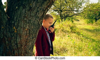 boy with a walkie-talk in nature