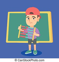 Boy with abacus on the background of blackboard.