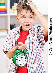 Boy with alarm clock