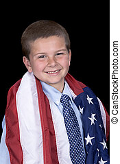 Boy with American flag around shoulders - A young boy with a...