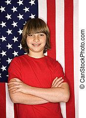 Boy with American flag.
