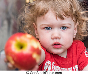 Boy with an apple in his hand