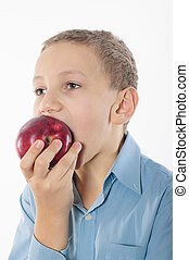 Boy with an apple on a white backg