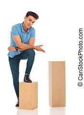 boy with an leg on a box