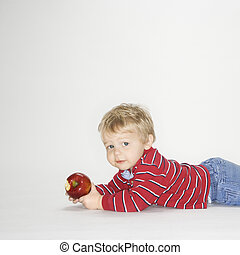 Boy with apple.